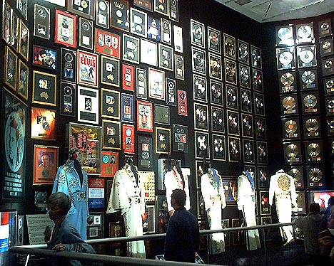 wall of records and suits